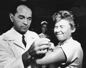 In 1957 the vaccine was too late to help most - Dr. Joseph Ballinger giving Marjorie Hill, a nurse at Montefiore Hospital in New York, the first Asian flu vaccine shot to be administered in New York City.