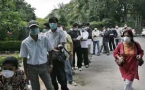 eople queue at a swine flu examination center  in Bangalore India on Monday
