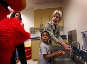 Here Elmo is explaing to Health and Human Services Secretary Kathleen Sebelius and a very interested child how to wash their hands