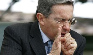 Álvaro Uribe sneezes  - please work on your cough etiquette and set an example