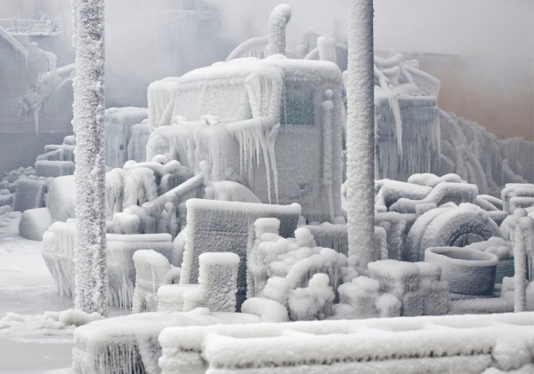 Fire and Ice combined - An ice-encrusted truck is blanketed in smoke after a warehouse fire in Chicago, on January 23, 2013.