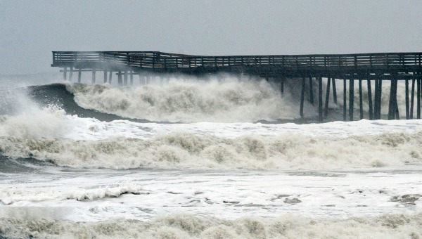 October 29, 2012: Waves crash on shore from high surf ahead of Hurricane Sandy at the pier at Virginia Beach, Virginia. (Rich-Joseph Facun/Reuters) October 29, 2012: Waves crash on shore from high surf ahead of Hurricane Sandy at the pier at Virginia Beach, Virginia.
